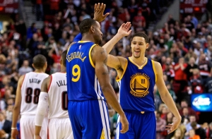 Nov 2, 2014; Portland, OR, USA; Golden State Warriors guard Klay Thompson (11) and guard Andre Iguodala (9) high five during the fourth quarter against the Portland Trail Blazers at the Moda Center. Mandatory Credit: Craig Mitchelldyer-USA TODAY Sports