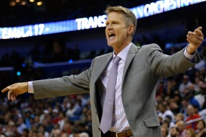 Golden State Warriors head coach Steve Kerr reacts during the second half of an NBA basketball game against the New Orleans Pelicans in New Orleans, Sunday, Dec. 14, 2014. The Warriors won 128-122 in overtime. (AP Photo/Jonathan Bachman)